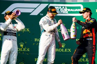 Lewis Hamilton, Mercedes AMG F1, 2nd position, Valtteri Bottas, Mercedes AMG F1, 1st position, and Max Verstappen, Red Bull Racing, 3rd position, celebrate with Champagne on the podium