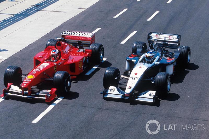 Michael Schumacher, Ferrari F399, Mika Häkkinen, McLaren MP4/14