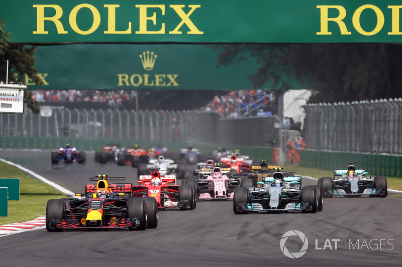 Max Verstappen, Red Bull Racing RB13 leads at the start of the race with Lewis Hamilton, Mercedes-Be