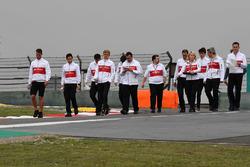 Charles Leclerc, Sauber and Marcus Ericsson, Sauber walk the track