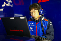 A Toro Rosso Honda engineer at work on a laptop