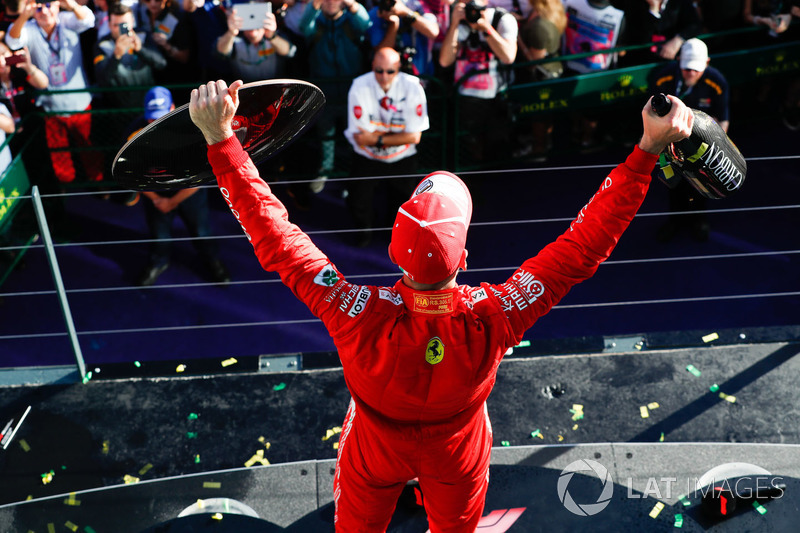 Race winner Sebastian Vettel, Ferrari, with his trophy and Champagne