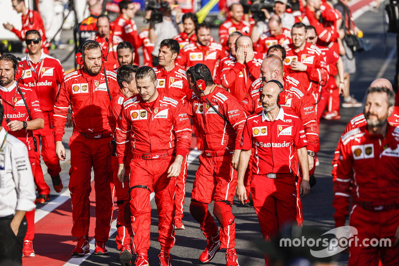 Ferrari engineers head to Parc Ferme to celebrate victory