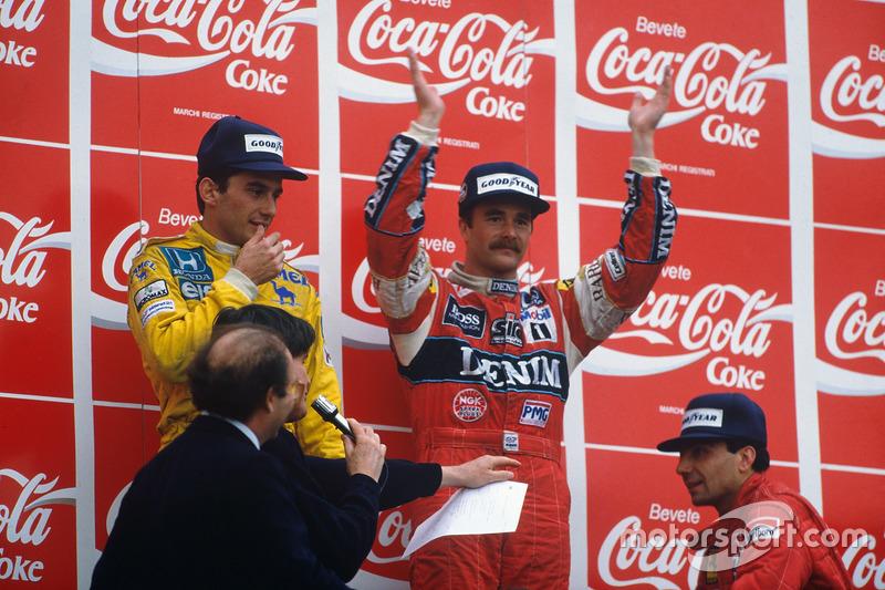 Podium : le vainqueur Nigel Mansell, Williams, le second Ayrton Senna, Team Lotus, le troisième Michele Alboreto, Ferrari