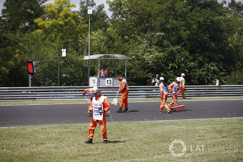 Marshals sweep the track clean