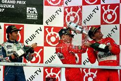 Podium: race winner Michael Schumacher, Ferrari, second place Heinz-Harald Frentzen, Williams Renault, third place Eddie Irvine, Ferrari