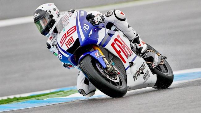 Lorenzo il più veloce sotto la pioggia portoghese