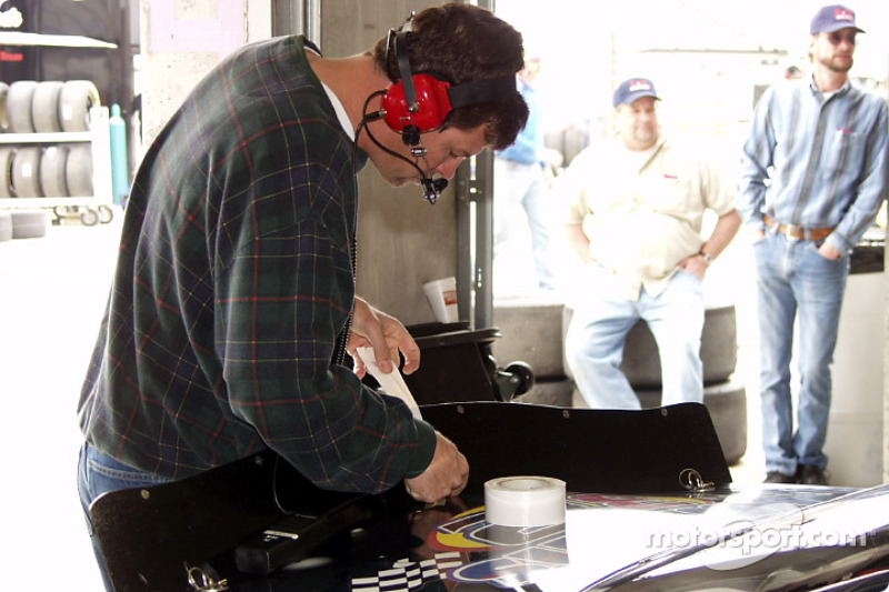 M Waltrip working on Shawna's car