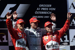 The podium: Michael Schumacher, David Coulthard and a disappointed Rubens Barrichello