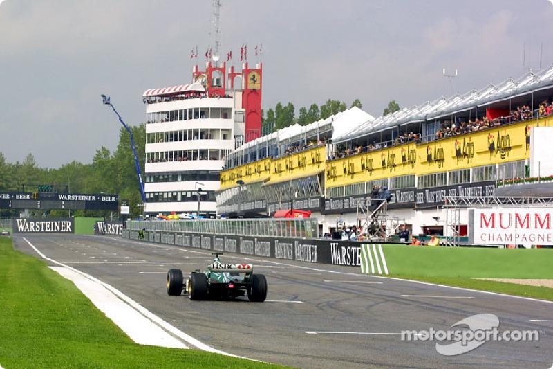 A Jaguar passing the pits