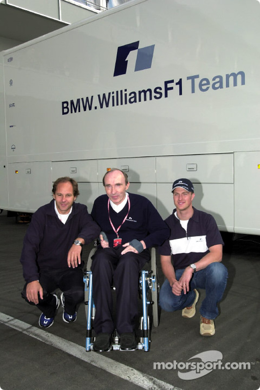 Ralf Schumacher, here with Gerhard Berger and Frank Williams, agrees a new contract with the BMW Wil