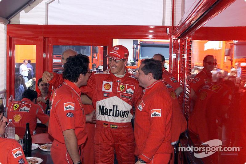 Luca Baldisseri, Michael Schumacher y Jean Todt