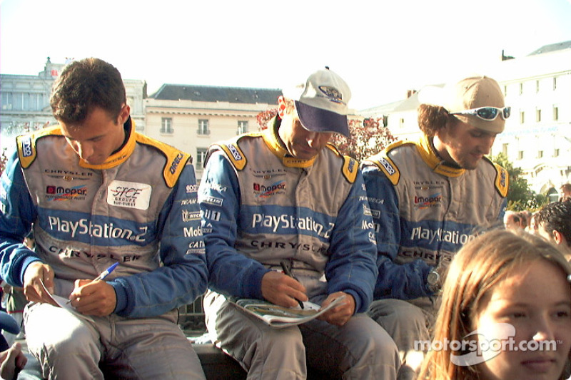 Chrysler drivers signing autographs nonstop