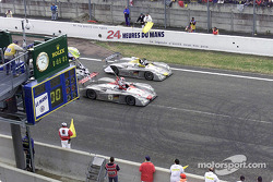 Audi celebrates a 1-2 at Le Mans: Emanuele Pirro in the Infineon Audi R8 (#1) crosses the finishing line ahead of Laurent Aiello (#2)