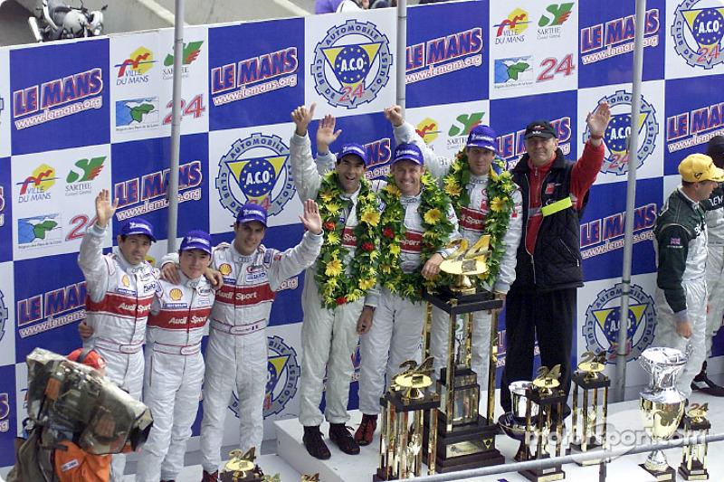 The podium: Rinaldo Capello, Christian Pescatori, Laurent Aiello, Emanuele Pirro, Tom Kristensen, Frank Biela, and Audi Sportchef Dr. Wolfgang Ullrich