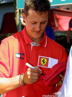 Michael signing autographs