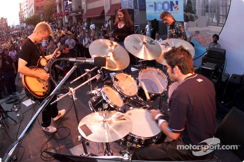 Patrick Carpentier keeps the beat for his CART band RPM (acronym for Racing Powered Music) during their premiere show at Gretzky's in Toronto, with Kenny Brack on guitar, vocals by CART promotions Elizabeth Fornal, and Mo Nunn Racing's Laz Denez on bass