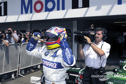 Juan Pablo Montoya celebrating his first pole position in Formula 1
