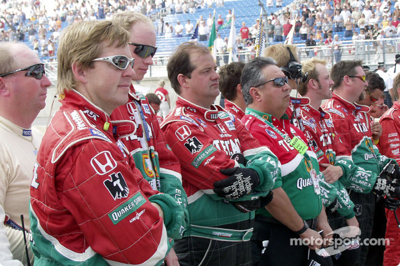 Before the race: Adrian Fernandez' crew listen to the invocation