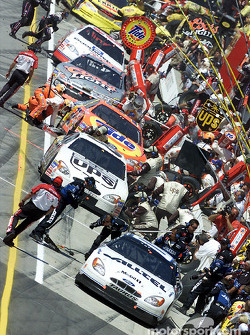 Ryan Newman, Dale Jarrett and Ricky Craven pit for service