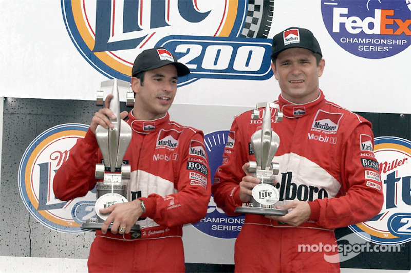 The podium: Helio Castroneves and Gil de Ferran