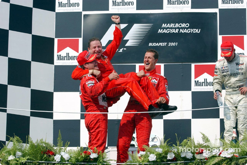 Michael Schumacher, Rubens Barrichello and Jean Todt celebrating