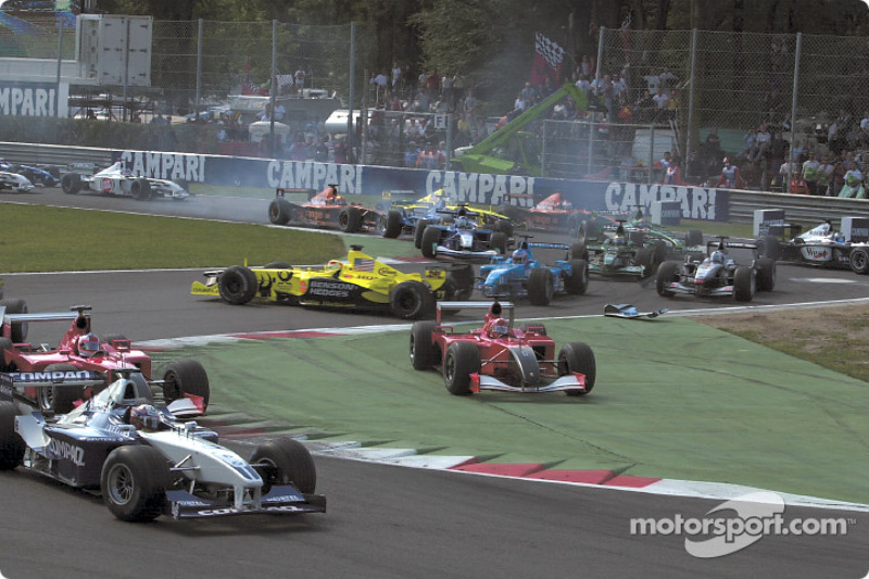 First corner: Juan Pablo Montoya already leading and trouble at the back