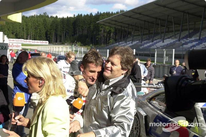 Bernd Schneider and Norbert Haug celebrating