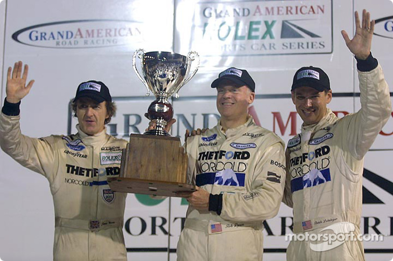 James Weaver, Rob Dyson and Butch Leitzinger hoist their points championship trophy in victory lane at Daytona