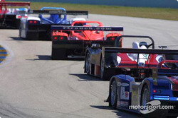 A string of SRP cars weave their way through a turn at Homestead-Miami Speedway