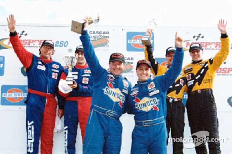 Doug Goad and Devon Powell are joined on the podium by the drivers of the Motorsports Technologies and Speedsource Porsches
