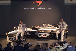 Kimi Raikkonen and David Coulthard with the new McLaren Mercedes MP4-17