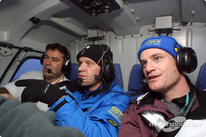 Subaru driver Tommi Makinen hitching a lift home in the WRC television helicopter after retiring on SS4