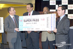 Chris Lencheski, founder and COB of the National Grand Prix Holdings, and Bill Hanbury, President of the Washington, DC Convention and Tourism Corporation, present the first ticket to two DC Council members