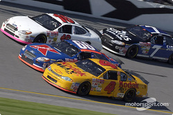 Todd Bodine and Greg Biffle pass Mike Skinner as they race 3 wide through the tri-oval