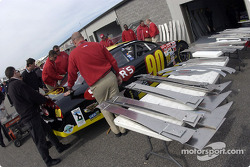 NASCAR inspectors check the Ford Taurus of Rick Mast