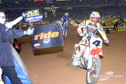 Ricky Carmichael and Jeremy McGrath fly past the mechanic's area and get their lap times