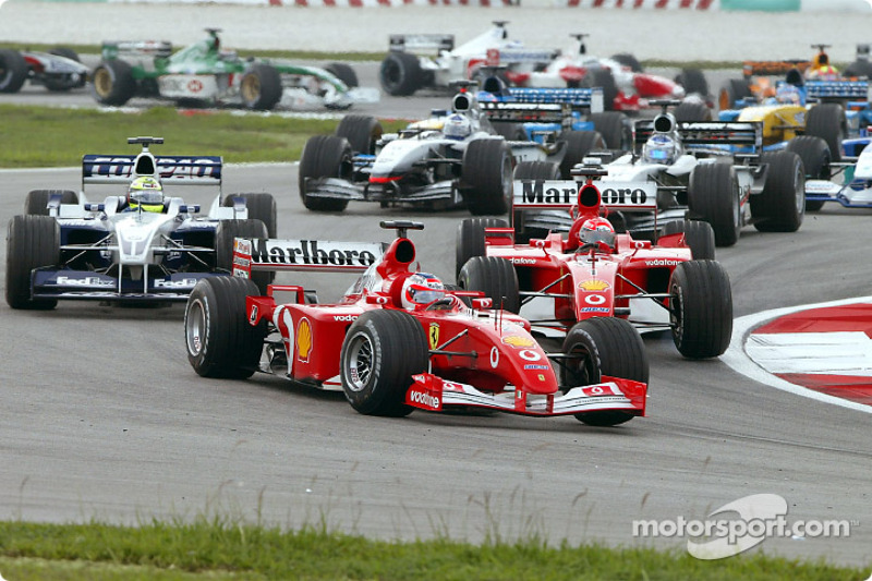 First corner: Rubens Barrichello leading Ralf Schumacher and Michael Schumacher