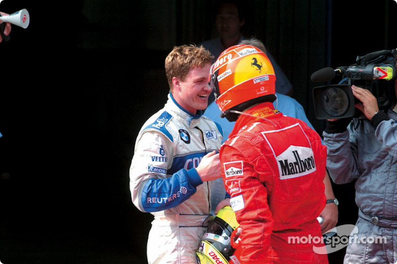 Ralf Schumacher congratulated by brother Michael