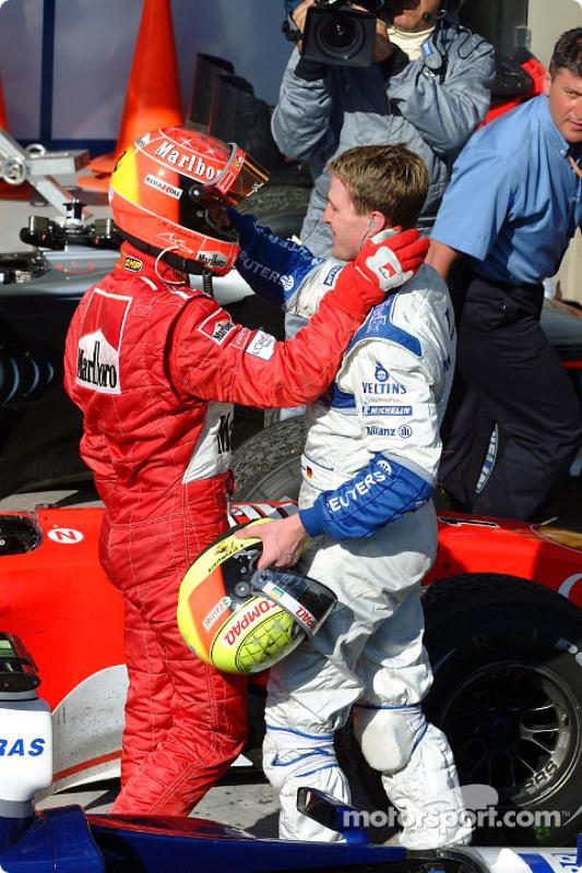 Race winner Michael Schumacher and brother Ralf