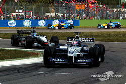 Juan Pablo Montoya in front of Kimi Raikkonen
