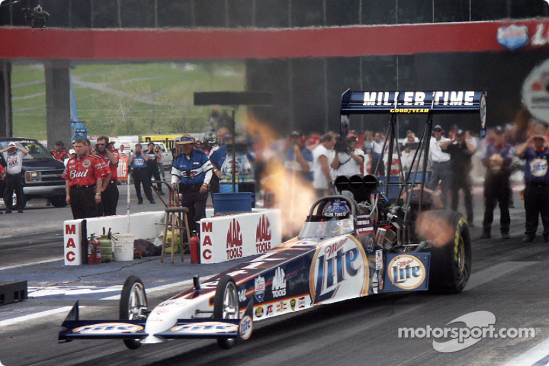 Larry Dixon takes off in the Miller Lite Top Fuel car