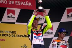 Rossi raises trophy