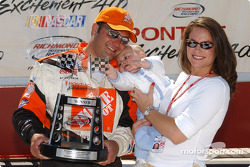 Nan Zipadelli (right) stops in victory lane with son Zachary and husband Greg following The Home Depot Racing Team's wi