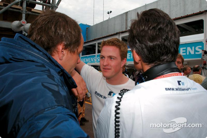 Ralf Schumacher talking with Gerhard Berger