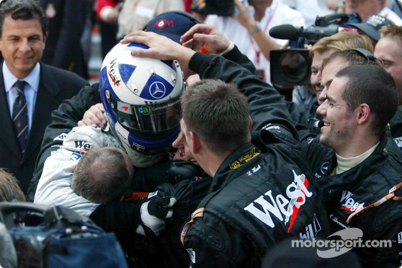 Race winner David Coulthard celebrating with Team McLaren crew members