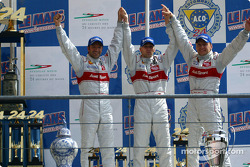 The overall and LMP 900 - LM GTP podium: third place Michael Krumm, Marco Werner and Philipp Peter