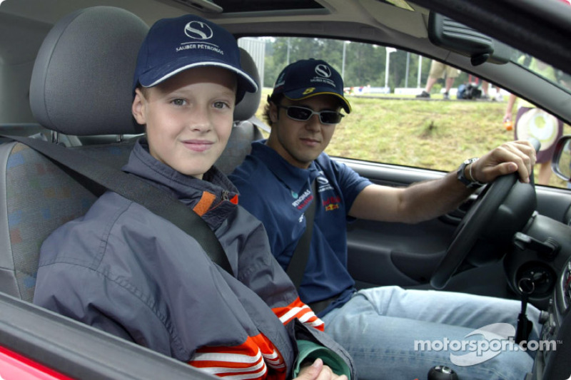Nick Heidfeld and Felipe Massa giving lessons at the Driving Safety Center in Nürburgring, to the ch