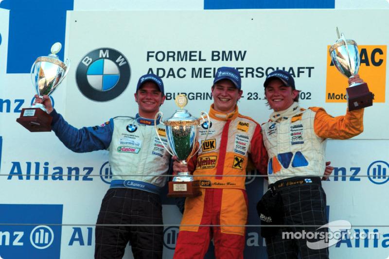 El ganador del primer heat del Campeonato Fórmula BMW ADAC, Hannes Neuhauser con Christian Mamerow y Nico Rosberg