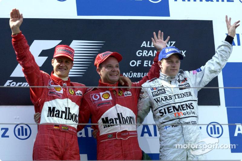 The podium: race winner Rubens Barrichello with Michael Schumacher and Kimi Raikkonen